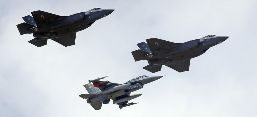An F-16, below, escorts two F-35 jets, above, after arriving at it new operational base Wednesday, Sept. 2, 2015, at Hill Air Force Base, in northern Utah.