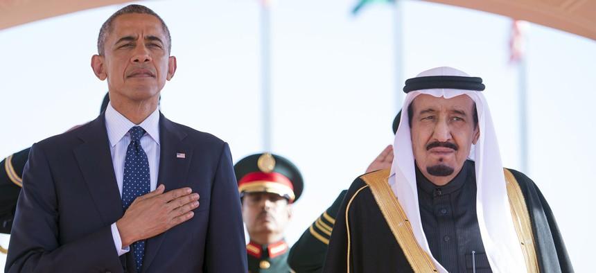 In this Tuesday, Jan. 27, 2015 photo provided by the Saudi Press Agency, President Barack Obama and Saudi Arabian King Salman bin Abdul Aziz stand during the arrival ceremony in Riyadh, Saudi Arabia, Tuesday, Jan. 27, 2015.
