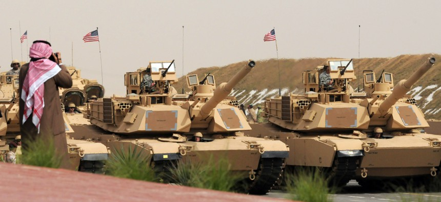 U.S. Army heavy battle tanks are seen during a military parade commemorating the 20th anniversary of the liberation of Kuwait from the 1990 Iraqi invasion in Subiya, Kuwait, Feb. 26, 2011.