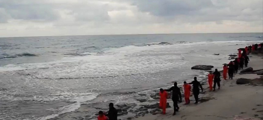 n this file image made from a video released Sunday, Feb. 15, 2015 by militants in Libya claiming loyalty to the Islamic State group purportedly shows Egyptian Coptic Christians in orange jumpsuits being led along a beach.