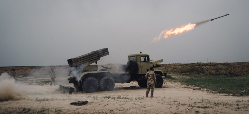 A rocket is fired from a rocket launcher outside Makhmour, about 75 km (47 miles) east of Mosul, Iraq, Friday, March 25, 2016.