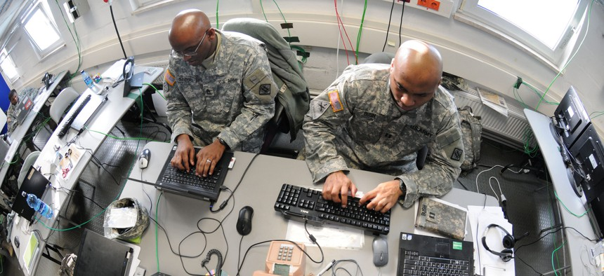 Soldiers from the 2nd Signal Brigade complete a mission in the Joint Cyber Control Center in Grafenwoehr, Germany, Feb. 23, 2011