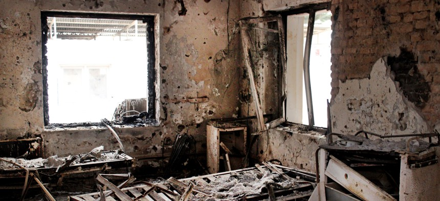 A Oct. 16, 2015 photo shows the charred remains of their hospital after it was hit by a U.S. airstrike in Kunduz, Afghanistan. The U.S. military is paying hundreds of thousands of dollars to wounded survivors and relatives of the 42 Afghans killed.