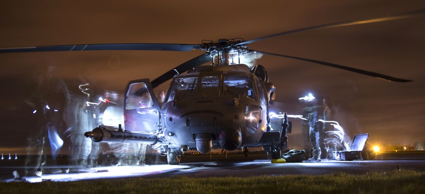 U.S. Airmen conduct post-flight inspections on an HH-60G Pave Hawk during exercise Voijek Valour at Hullavington Airfield, England, March 4, 2016.