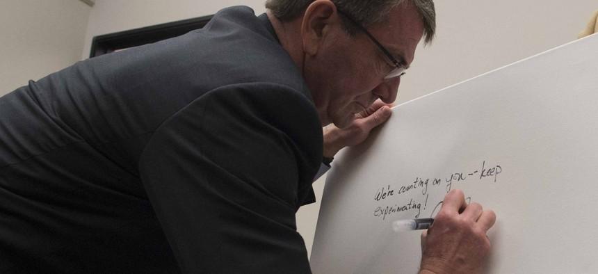Secretary of Defense Ash Carter signs the guest board at Galvanize San Francisco, March 1, 2016.