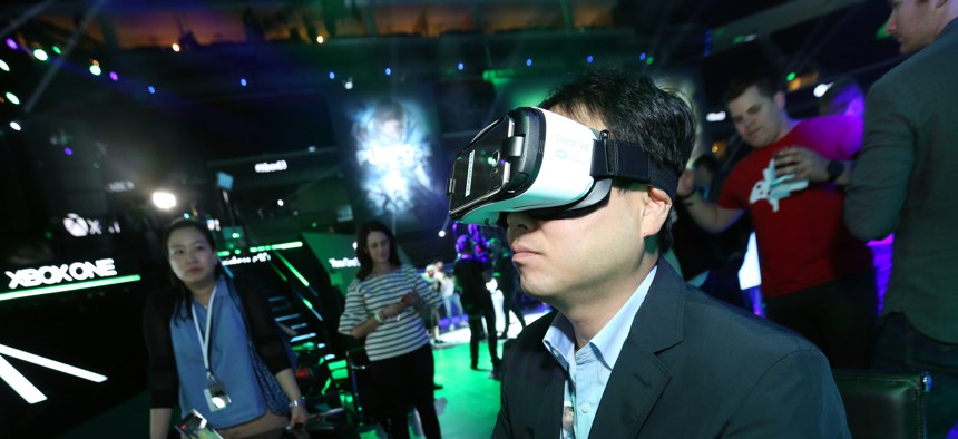 """Gamers experience """"Minecraft"""" with Oculus VR at the Xbox Media Showcase at E3 2016 in Los Angeles on Monday, June 13, 2016."""