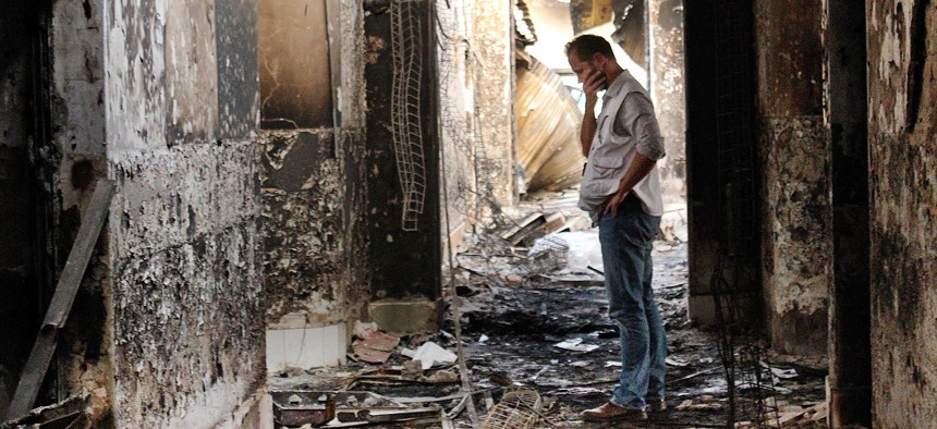 A Doctors Without Borders employee inside the charred remains of their hospital after it was hit by a U.S. airstrike in Kunduz, Afghanistan, killing 42 people.