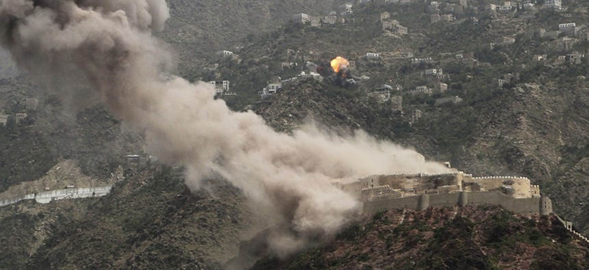 Smoke rises from al-Qahira castle, an ancient fortress that was recently taken over by Shiite rebels, as another building on the Saber mountain, in the background, explodes after Saudi-led air strikes in Taiz city, Yemen, in May 2015.