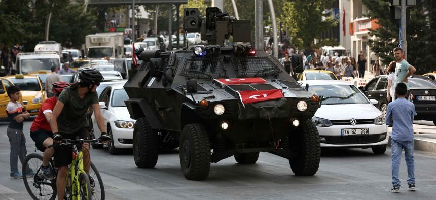 A police APC drives in the city center in Ankara, Turkey, Friday, July 22, 2016.