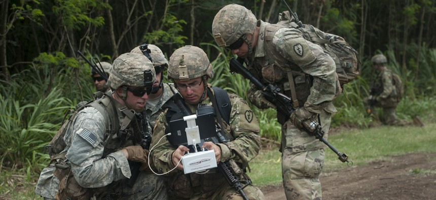 Soldiers flying a Quad Copter during the Pacific Manned Unmanned – Initiative July 22, 2016, at Marine Corps Training Area Bellows, Hawaii.