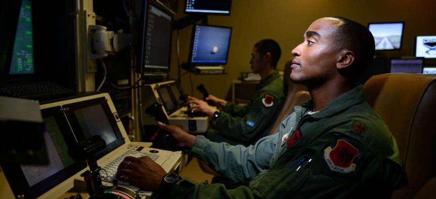 Maj. Bishane, a 432nd Aircraft Maintenance Squadron MQ-9 Reaper pilot, remotely controls an aircraft from Creech Air Force Base, Nev.