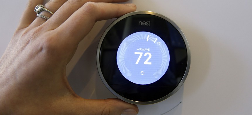 The Nest Learning Thermostat is on display following a news conference Wednesday, June 17, 2015, in San Francisco.