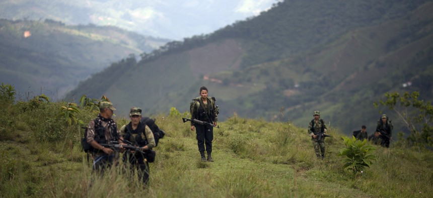 Members of the 36th Front of the Revolutionary Armed Forces of Colombia or FARC, trek to a new camp in Antioquia state, in the northwest Andes of Colombia, Jan. 3, 2016.