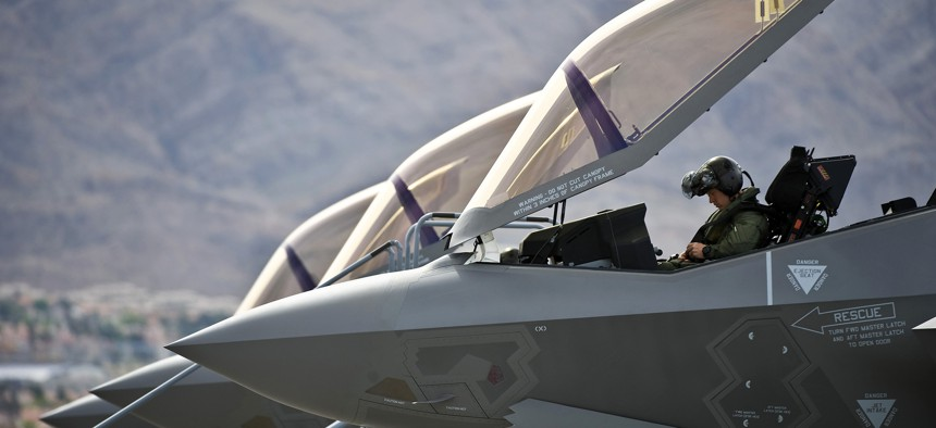 A U.S. Air Force pilot conducts preflight checks inside an F-35A Lightning II before a training mission April 4 at Nellis Air Force Base, Nev., April 4, 2013.