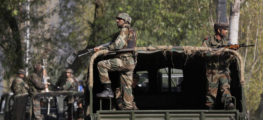 Indian soldiers guard outside the army base which was attacked Sunday by suspected militants at Uri, Indian controlled Kashmir, Monday, Sept. 19, 2016.