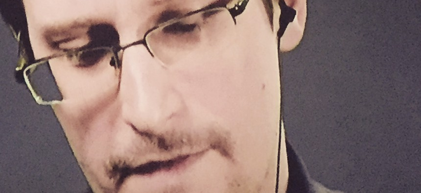 """Edward Snowden addresses an international audience remotely on the eve of the debut of """"Snowden,"""" September, 2016."""