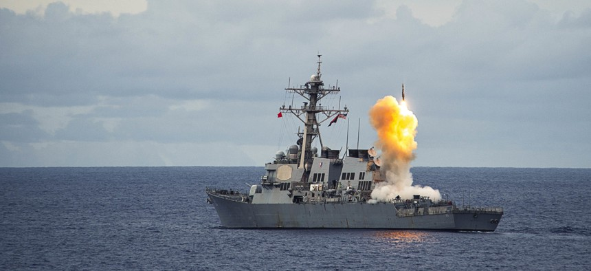 The Arleigh Burke-class guided-missile destroyer USS Benfold (DDG 65) fires a standard missile (SM 2) at a target drone as part of a surface-to-air-missile exercise (SAMEX) during Valiant Shield 2016 in the Philippine Sea, Sept 19, 2016.