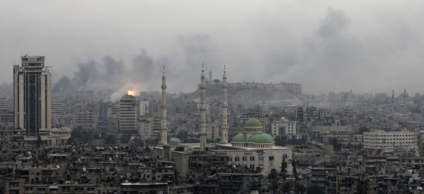 A ball of fire rises following a Syrian government air strike that hit rebel positions in the eastern neighborhoods of Aleppo, Syria, Monday, Dec. 5, 2016.