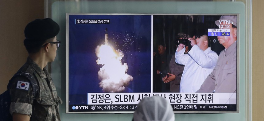 A South Korean army soldier watches a TV news program showing North Korea's ballistic missile believed to have been launched from underwater and North Korean leader Kim Jong-un, at Seoul Railway station in Seoul,Aug. 25, 2016.