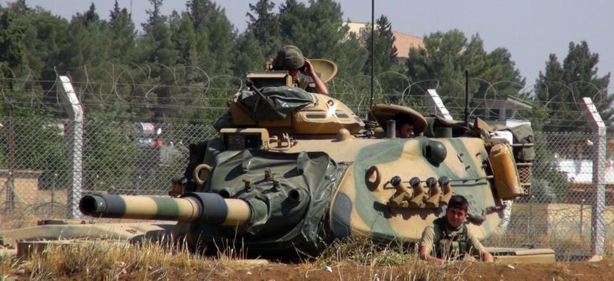 A Turkish army tank stationed near the Syrian border, in Suruc, Turkey, Saturday, Sept. 3, 2016.