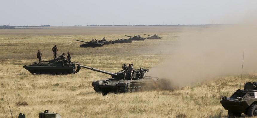 Ukrainian tanks and APCs move towards the de-facto border with Crimea near Kherson, southern Ukraine, Friday, Aug. 12, 2016.