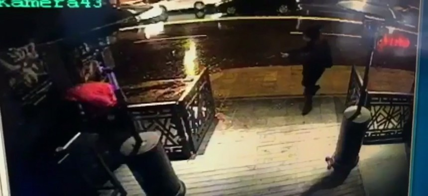 This image taken from CCTV provided by Haberturk Newspaper Sunday Jan. 1, 2017 shows the attacker, armed with a long-barrelled weapon, shooting his way into the Reina nightclub in Istanbul, Turkey on Sunday morning.