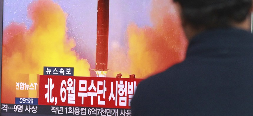 In this Oct. 16, 2016, file photo, a man watches a TV news program showing a file image of a missile launch conducted by North Korea, at the Seoul Railway Station in Seoul, South Korea.