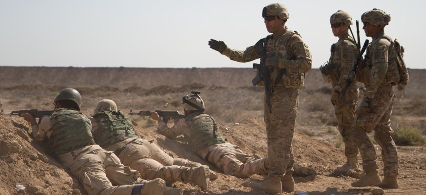 U.S. soldiers from the 82nd Airborne Division train Iraqi soldiers during a live-fire movement exercise at Camp Taji, Iraq, April 12, 2015.