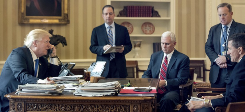 President Donald Trump, accompanied by, Chief of Staff Reince Priebus, Vice Pres. Mike Pence, Press Secretary Sean Spicer, and National Security Adviser Michael Flynn, speaks on the phone with with Russian President Vladmir Putin, Sat., Jan. 28, 2017.