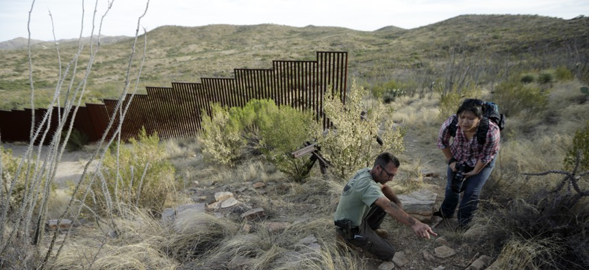 Near where a section of the border wall separating Mexico and the U.S. ends in Sasabe, Ariz., a journalist talks with a founder of a group of armed volunteers in the U.S. who dedicate themselves to border surveillance.