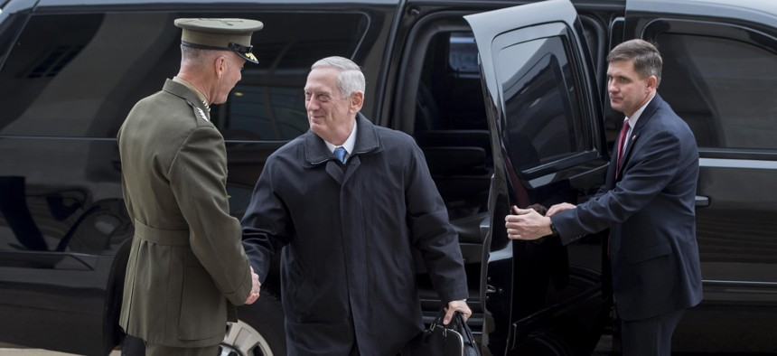 Defense Secretary Jim Mattis exchanges greetings with Marine Corps Gen. Joe Dunford, chairman of the Joint Chiefs of Staff, upon arriving at the Pentagon for his first full day as secretary, Jan. 21, 2017.