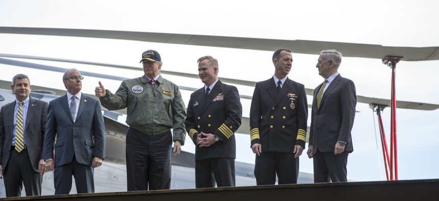 President Donald J. Trump gives a thumbs-up to the audience after his tour of Pre-Commissioning Unit Gerald R. Ford (CVN 78), March 2, 2017.