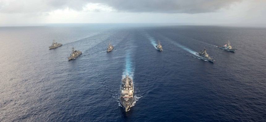 The Arleigh Burke-class guided-missile destroyer USS Mustin (DDG 89) leads U.S. Navy and Japanese ships in formation during MultiSail 17, March 10, 2017, in the Philippine Sea.