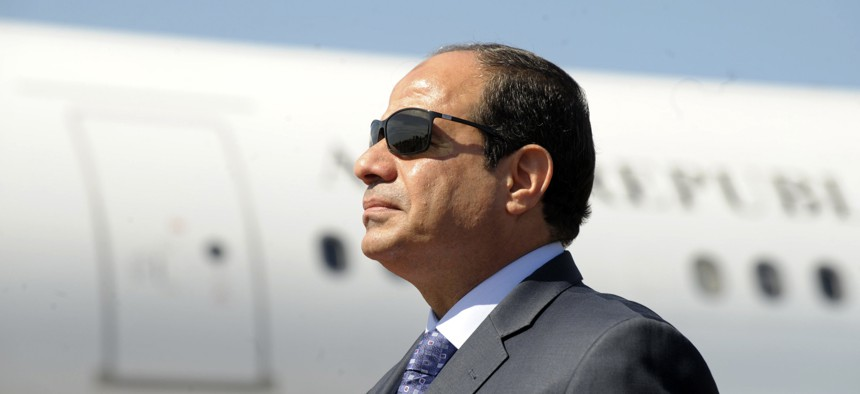 Egyptian President Abdel-Fattah el-Sissi stands at Algiers airport on his arrival to Algiers, Algeria, June 2014.