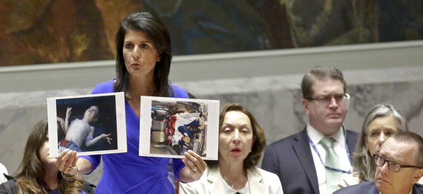 Nikki Haley, United States' Ambassador United Nations, shows pictures of Syrian victims of chemical attacks as she addresses a meeting of the Security Council on Syria at U.N. headquarters, Wednesday, April 5, 2017
