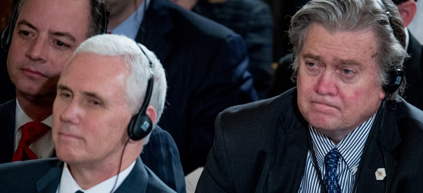From left, White House Chief of Staff Reince Priebus, Vice President Mike Pence, and Senior Adviser Steve Bannon attend a joint White House news conference with President Donald Trump and German Chancellor Angela Merkel on March 17, 2017.