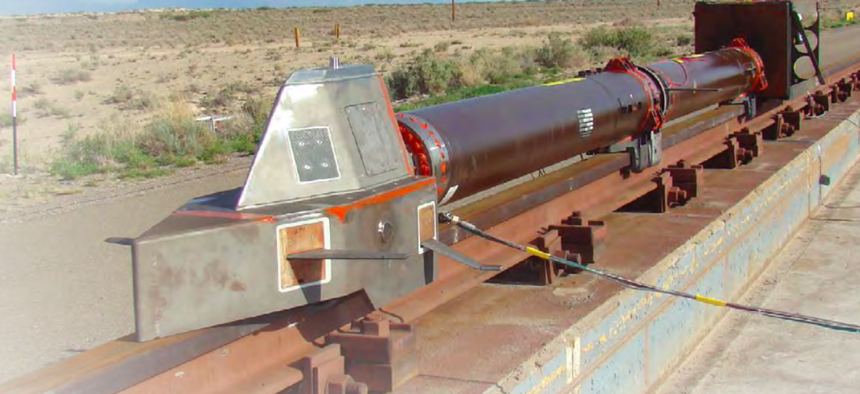 A monorail dry-run test at Holloman Air Force Base in July 2013 had no payload and used three representative carbon-epoxy panels mounted on the top and sides of the sled.