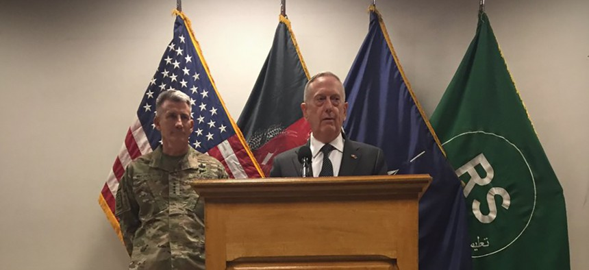 Defense Secretary Jim Mattis speaks to reporters from Resolute Support headquarters in Kabul, Afghanistan, as Gen. John Nicholson stands behind Mattis on April 24, 2017.