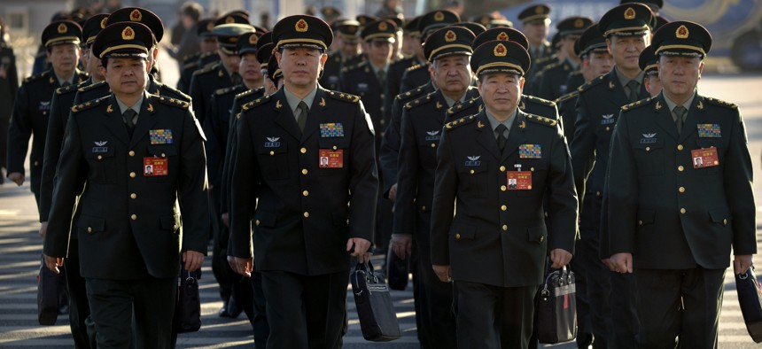 Military delegates arrive for a plenary session of the National People's Congress (NPC) at the Great Hall of the People in Beijing, China, in March.