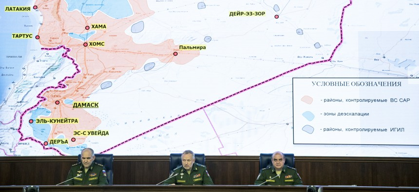 From left, Col. Gen. Sergei Rudskoi of the Russian General Staff, Deputy Defense Minister Alexander Fomin and Lt. Gen. Stanislav Gadzhimagomedov attend a briefing in the Defense Ministry in Moscow, Russia, Friday, May 5, 2017.