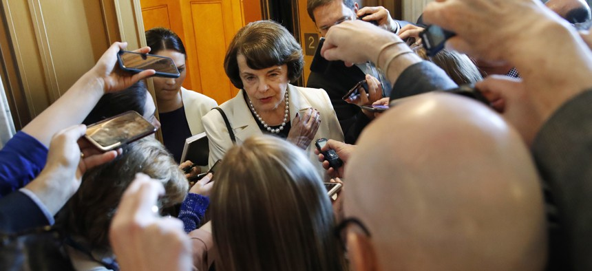 Sen. Dianne Feinstein, D-Calif., ranking member of the Senate Judiciary Committee, is asked questions by reporters about President Trump's decision to fire FBI Director James Comey, on Capitol Hill in Washington, Wednesday, May 10, 2017.