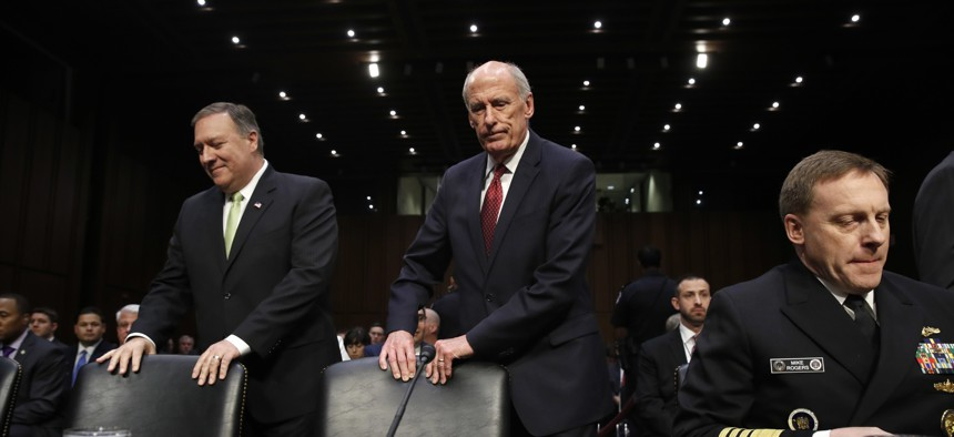 CIA Director Mike Pompeo, Director of National Intelligence Dan Coats, and NSA Director Adm. Michael Rogers on May 11, 2017, before testifying before the Senate Intelligence Commmittee.