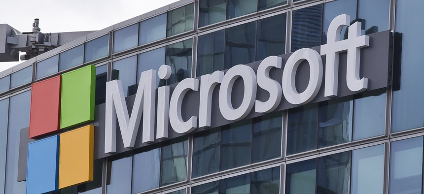 """This April 12, 2016 file photo shows the Microsoft logo in Issy-les-Moulineaux, outside Paris, France. The cyberextortion attack hitting dozens of countries was a """"perfect storm"""" of sorts."""