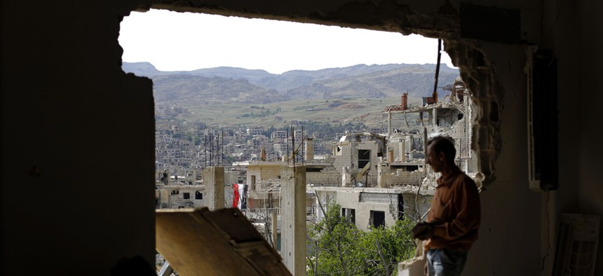 A man checks the damage at the mountain resort town of Zabadani in the Damascus countryside, Syria, Thursday, May 18, 2017.