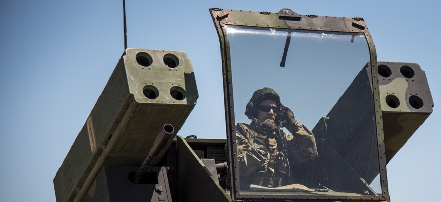 A soldier prepares to fire a Stinger missile from an Avenger vehicle at Eglin Air Force Base in Florida.