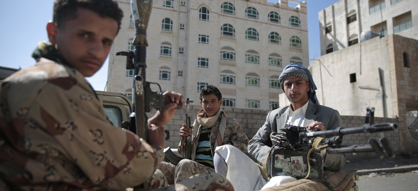 Shiite fighters, known as Houthis, pose for a photo as they secure a road, as people take part in a march, denouncing plans by the Arab coalition to attack Hodeidah, from Sanaa to the port city of Hodeidah, Yemen, on April 19, 2017.