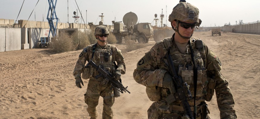 U.S. Army soldiers move through Qayara West Coalition base in Qayara, some 50 kilometers south of Mosul, Iraq.