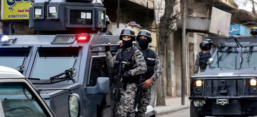 """""""Jordanian intelligence services work closely with the country's security forces, as in this March 2016 raid in downtown Irbid, which targeted extremists planning attacks on military and civilian targets."""""""