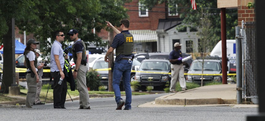 FBI agents investigate the scene at the YMCA in Alexandria, Va., Thursday, June 15, 2017, the day after House Majority Whip Steve Scalise of La. was shot during during a congressional baseball practice nearby.
