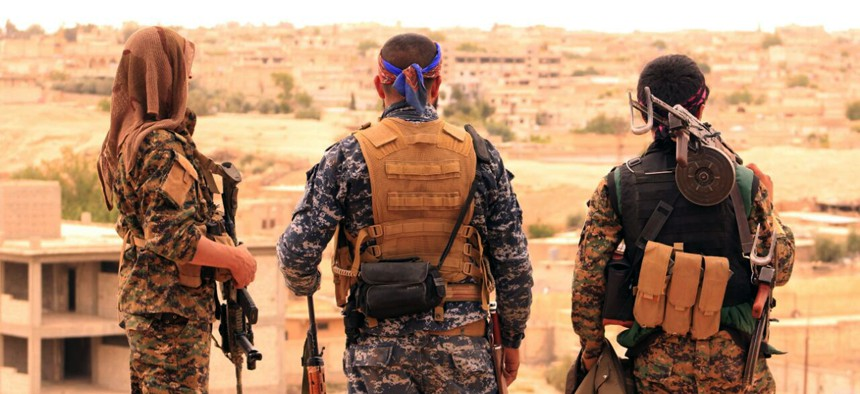 Syrian Democratic Forces looking toward the northern town of Tabqa, Syria. Photo provided Sun., Apr. 30, 2017.